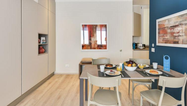 Dining table at Duomo Apartments - Citybase Apartments