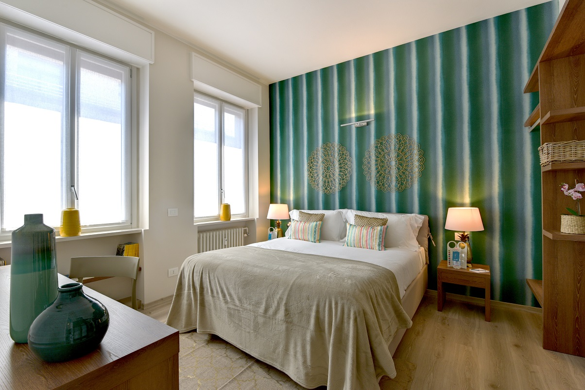 Bright bedroom at Duomo Apartments - Citybase Apartments