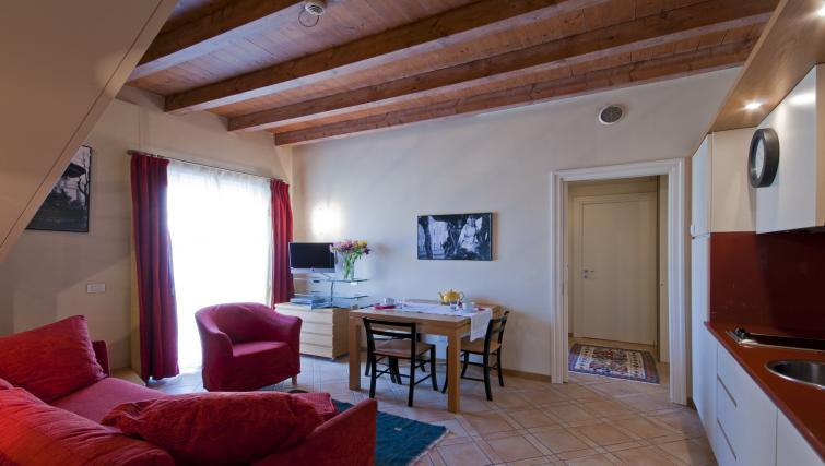 Open-plan living area at Residenza Ascanio Sforza - Citybase Apartments