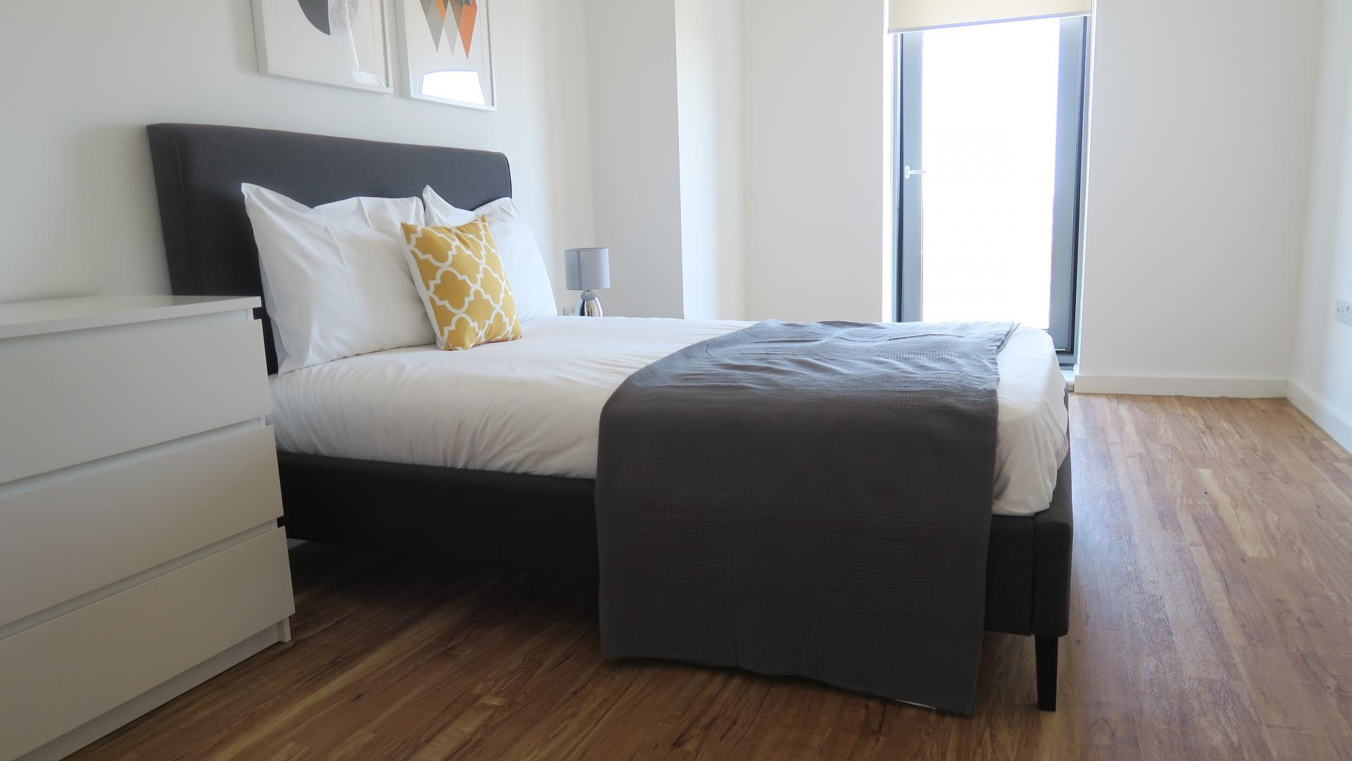 Bright bedroom at Quay Apartments @ Michigan - Citybase Apartments