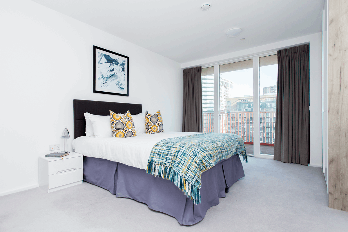 Spacious bedroom at Clover Court Apartments - Citybase Apartments