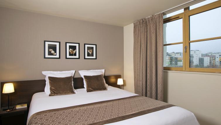 Bedroom at Residhome Caserne De Bonne - Citybase Apartments