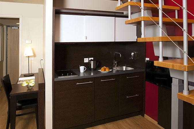 Kitchen area at Residhome Caserne De Bonne - Citybase Apartments