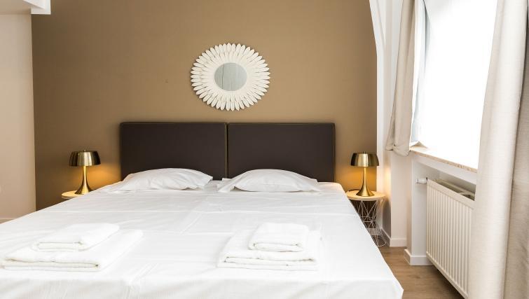 Bedroom at Avenue Michel Apartments - Citybase Apartments