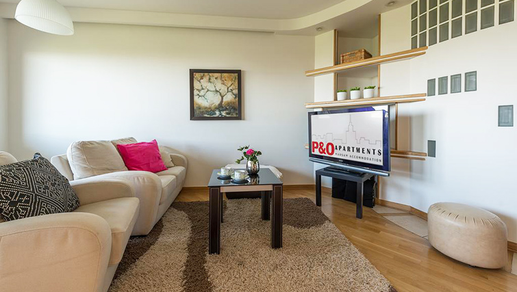 Living area at Zelazna Brewery Apartment - Citybase Apartments