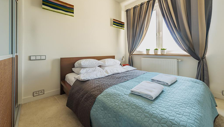 Bedroom at Zelazna Brewery Apartment - Citybase Apartments
