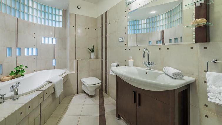 Bathroom at Zelazna Brewery Apartment - Citybase Apartments