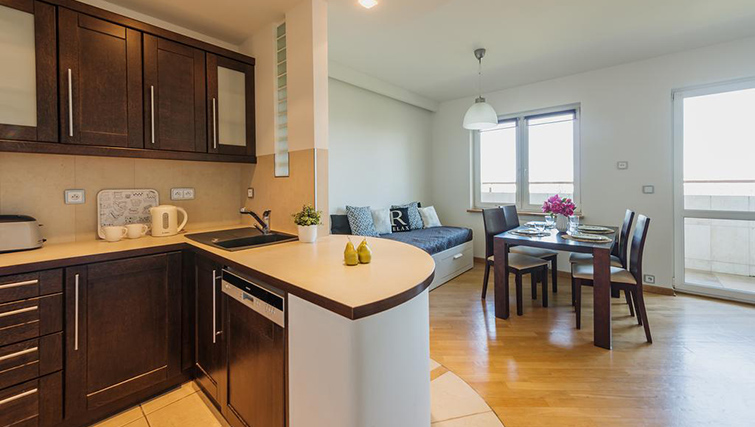 Kitchen at Zelazna Brewery Apartment - Citybase Apartments