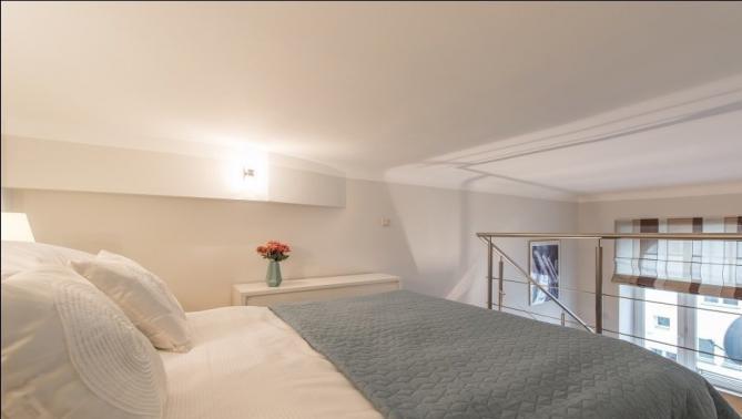 Bedroom at Hoza Apartment - Citybase Apartments