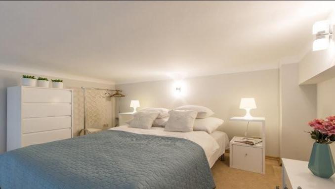 Bright bedroom at Hoza Apartment - Citybase Apartments