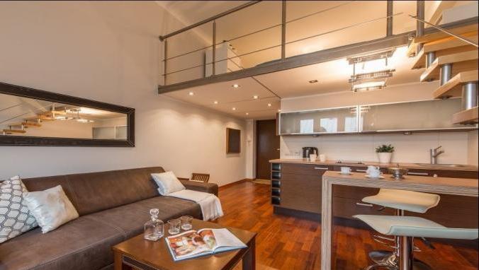 Living room at Hoza Apartment - Citybase Apartments