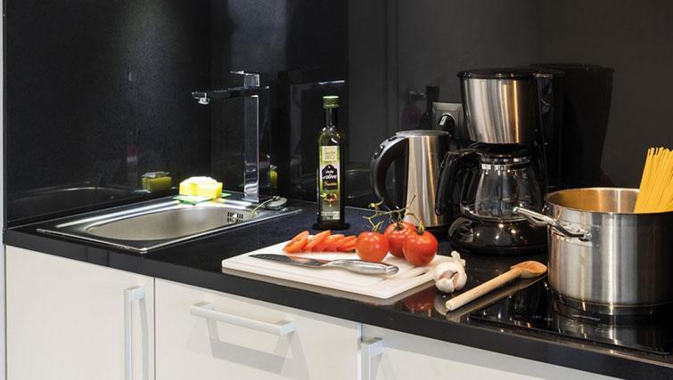 Kitchen at Hipark by Adagio Paris La Villette - Citybase Apartments