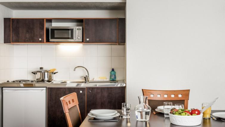 Kitchen at Adagio Access Paris Philippe Auguste - Citybase Apartments