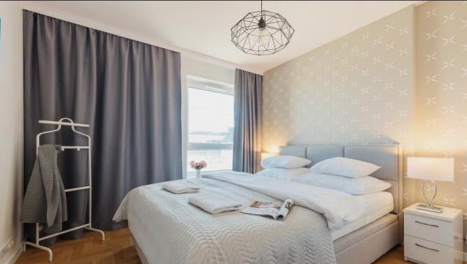 Bedroom at Konstruktorska Apartment - Citybase Apartments