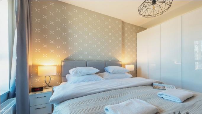 Modern bedroom at Konstruktorska Apartment - Citybase Apartments