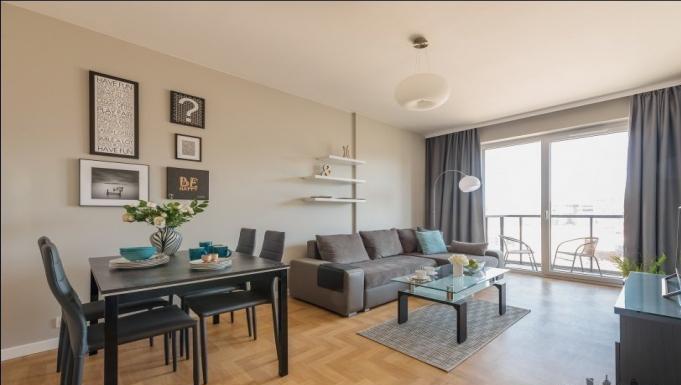 Living room at Konstruktorska Apartment - Citybase Apartments