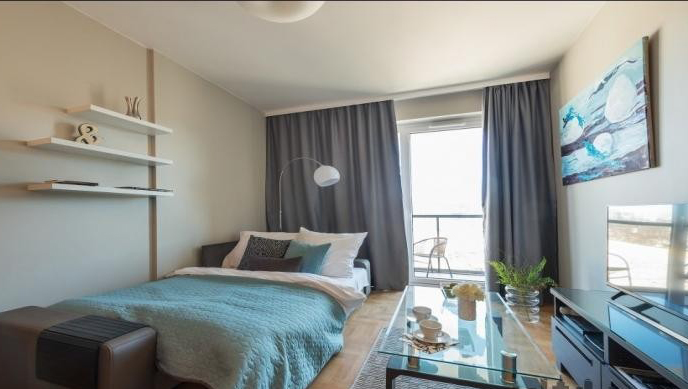 Bright bedroom at Konstruktorska Apartment - Citybase Apartments