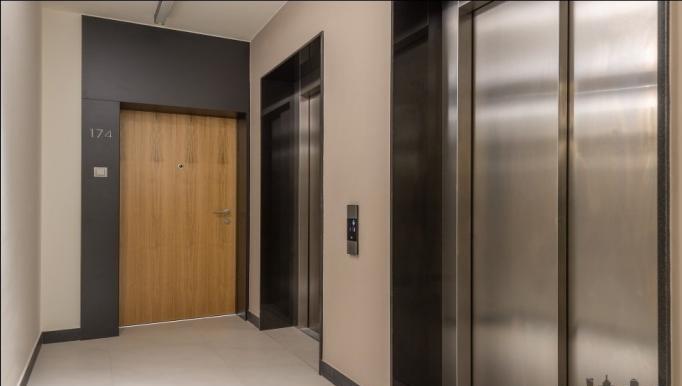 Lifts at Konstruktorska Apartment - Citybase Apartments