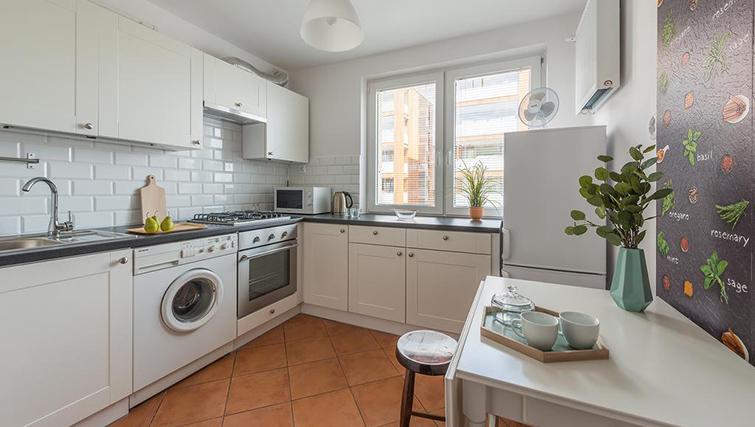 Kitchen at Pulawska Apartment - Citybase Apartments