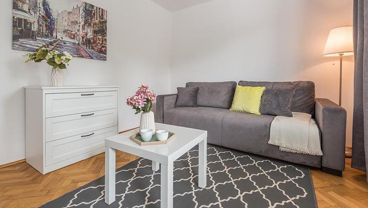 Sofa at Pulawska Apartment - Citybase Apartments
