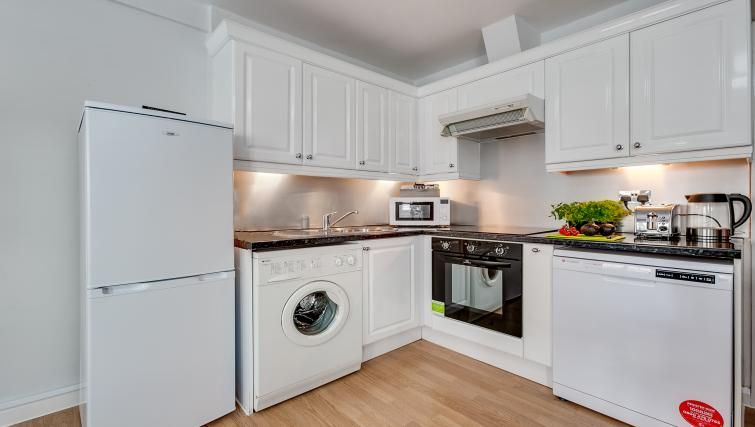 White kitchen at Nell Gwynn Chelsea Accommodation - Citybase Apartments