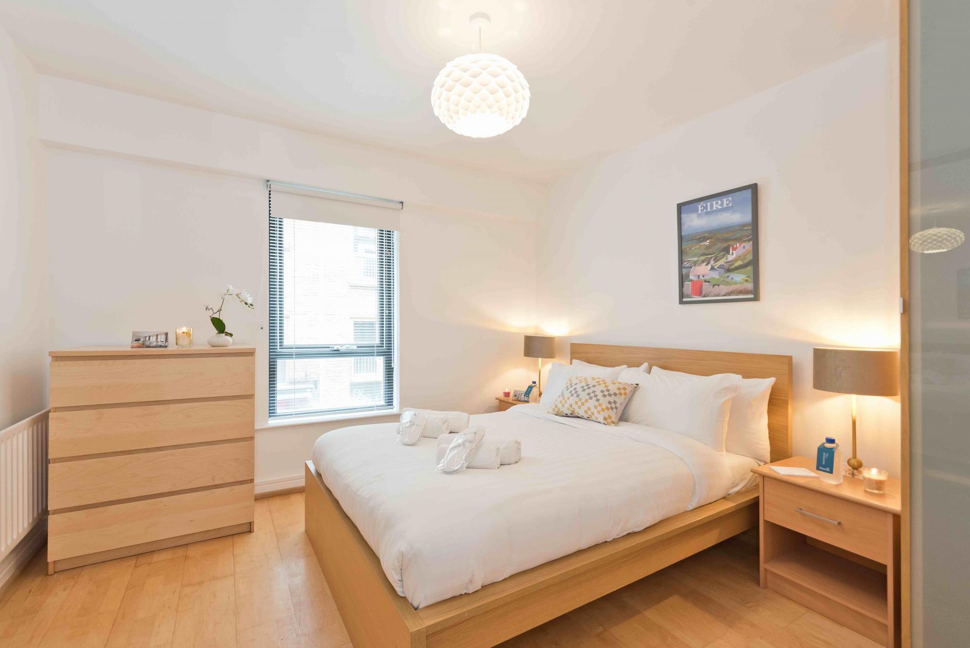 Bright bedroom at Sauls Court Apartments - Citybase Apartments