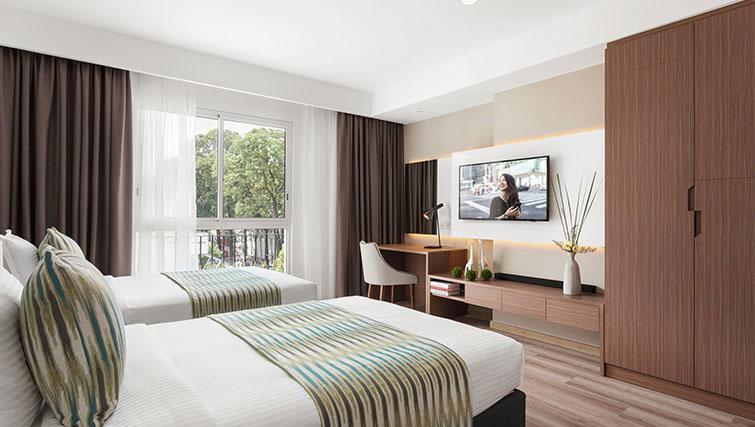 Twin beds at Citadines Regency Saigon Apartments - Citybase Apartments