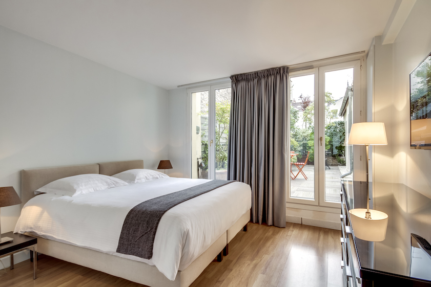 Bedroom at Rue Du Mail Apartments - Citybase Apartments