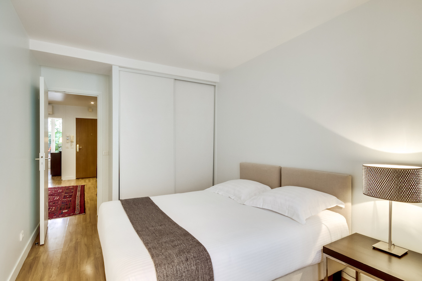 Spacious bedroom at Rue Du Mail Apartments - Citybase Apartments