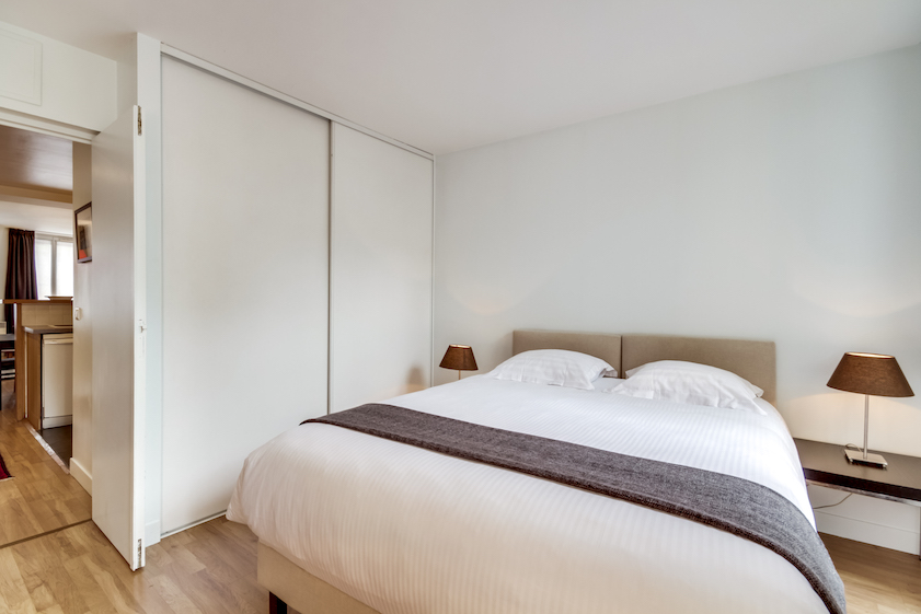 Bright bedroom at Rue Du Mail Apartments - Citybase Apartments