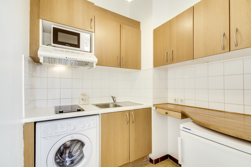 Laundry facilities at Rue Du Mail Apartments - Citybase Apartments