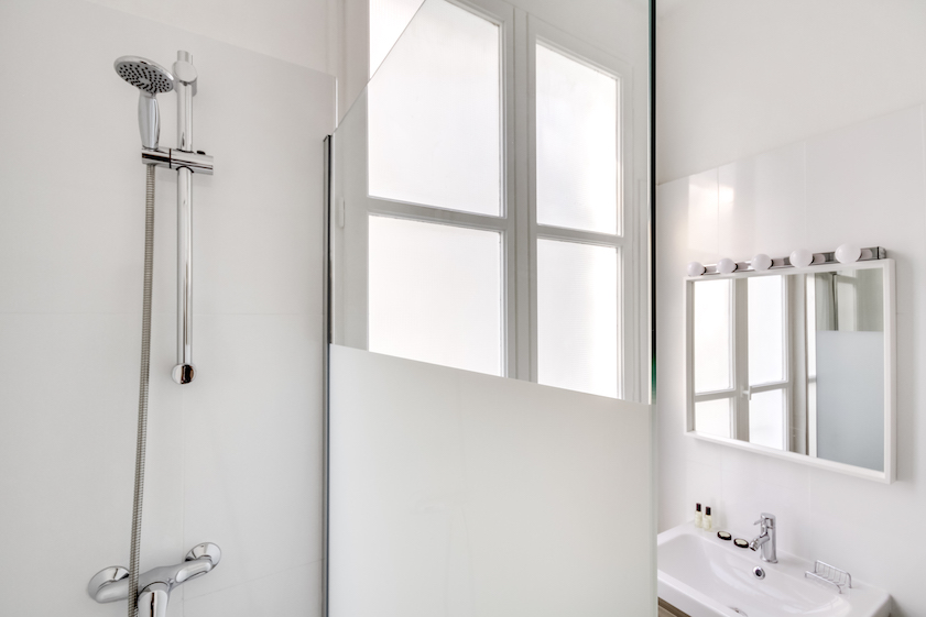 Bathroom shower at Rue Du Mail Apartments - Citybase Apartments
