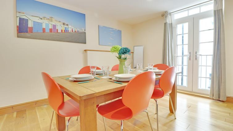 Dining table at Pebble Mews House - Citybase Apartments