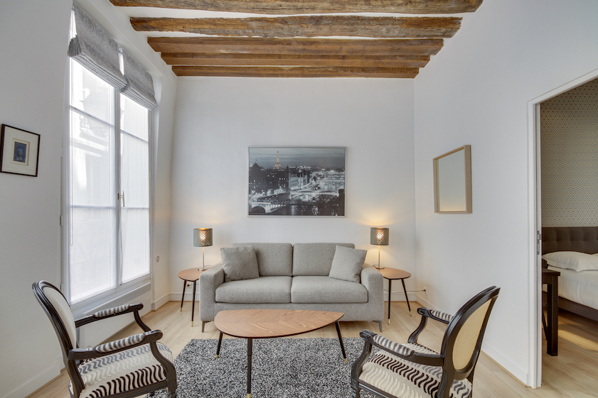 Living area at Rue Saint-Sauveur Apartments - Citybase Apartments