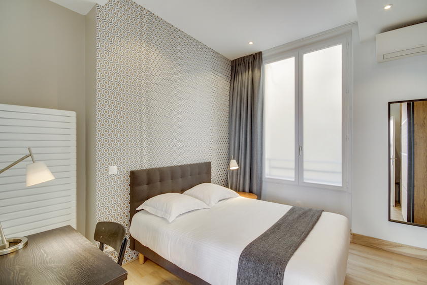 Bedroom at Rue Saint-Sauveur Apartments - Citybase Apartments