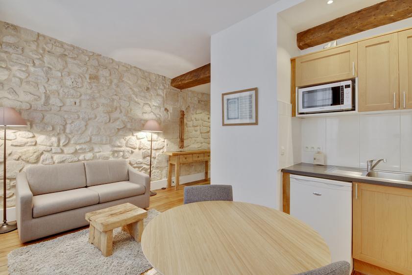 Exposed brick at Rue Saint-Sauveur Apartments - Citybase Apartments