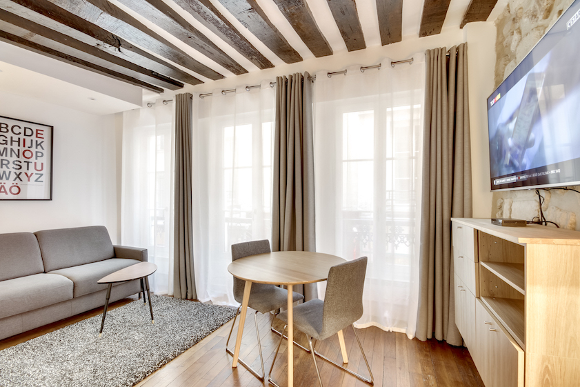 Dining table and chairs at Rue Saint-Sauveur Apartments - Citybase Apartments
