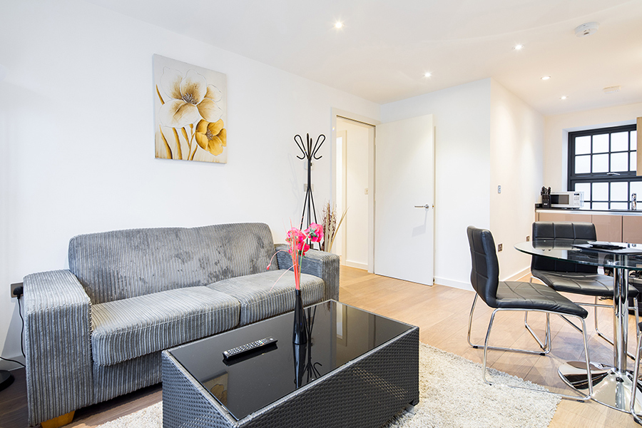 Sofa at Omega Place Apartment - Citybase Apartments