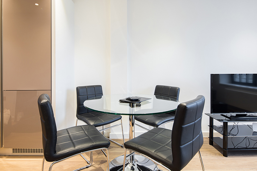 Dining table at Omega Place Apartment - Citybase Apartments