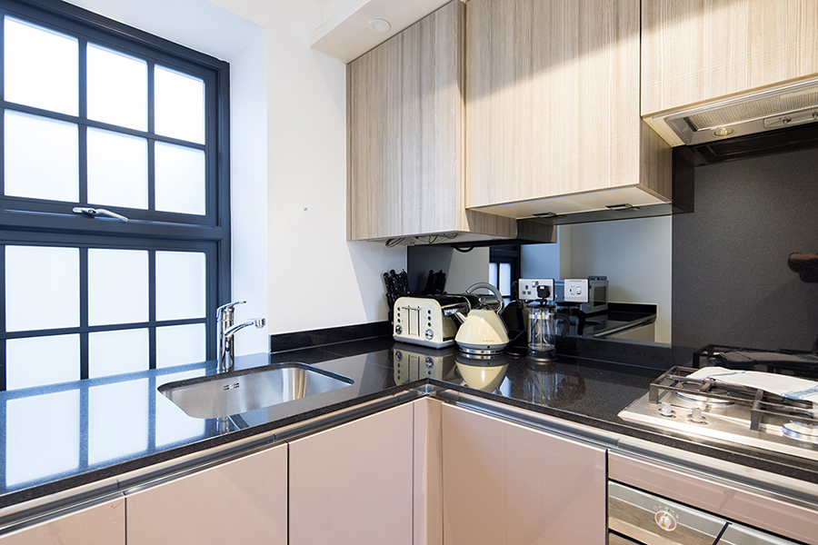 Kitchen facilities at Omega Place Apartment - Citybase Apartments