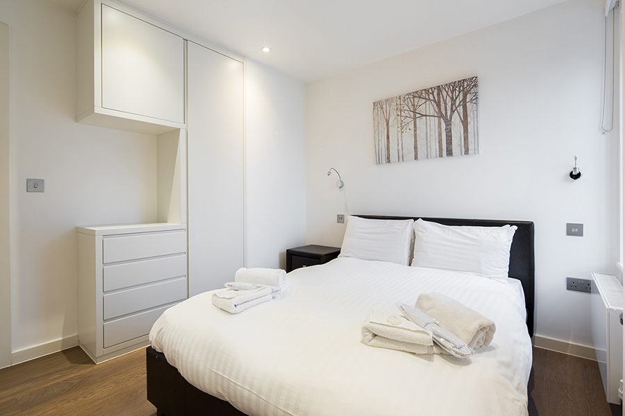 Bright bedroom at Omega Place Apartment - Citybase Apartments