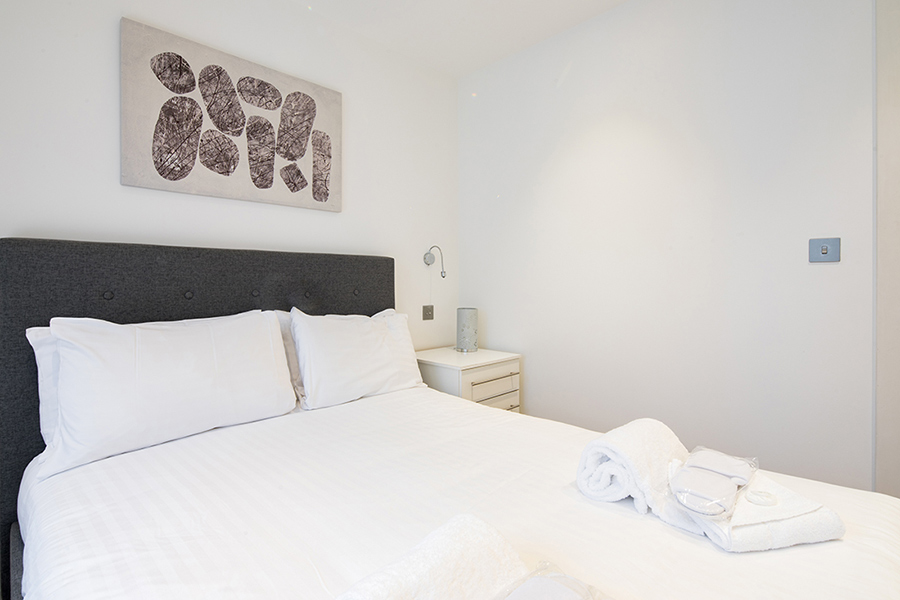 Double bed at Omega Place Apartment - Citybase Apartments