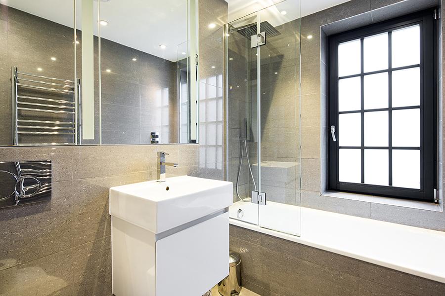 Bath at Omega Place Apartment - Citybase Apartments