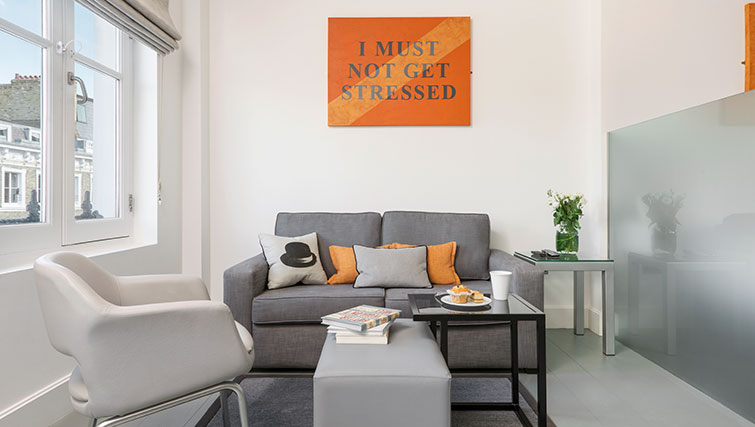 Sofa at Templeton Place Aparthotel - Citybase Apartments