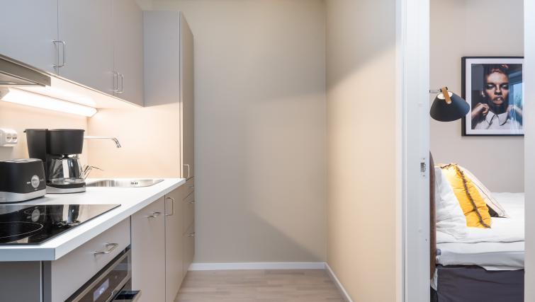 Kitchen area at Lagårdsveien 61 Serviced Apartments - Citybase Apartments