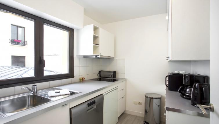 Kitchenette at Lunes Apartments - Citybase Apartments