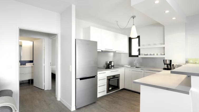 Modern kitchen at Lunes Apartments - Citybase Apartments