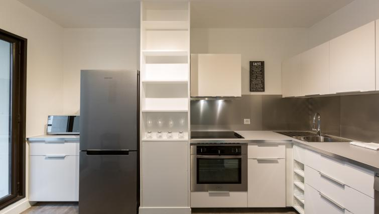 Modern kitchenette at Lunes Apartments - Citybase Apartments