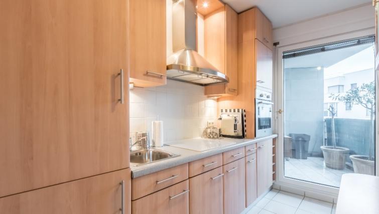 Kitchen at Falguiere Apartment - Citybase Apartments