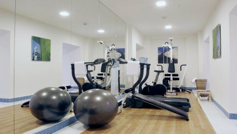 Inviting gym at Mamaison Residence Sulekova - Citybase Apartments
